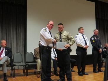 Dep. Christopher Manno Jr. receives his certificate from Maj. David DiMaggio.