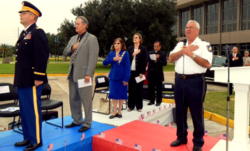 Maj. Mark Poche of the Sheriff's Office recites the Pledge of Allegiance at the start of the ceremony.
