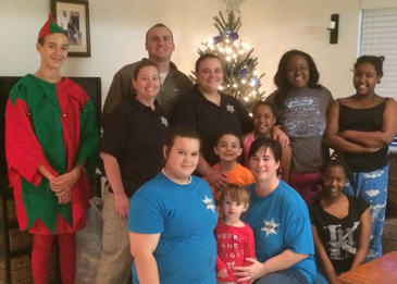 In front, from left, are Kaya Penton, Jaxson Allnet, below him Jackie Penton, Lt. Jamie Penton, and Tijae Hugle. In back are Seth Penton, Cpl. Wayne Babin Jr., Capt. Angela Huff, Sgt. Jennifer Dassau, and family members Tireill Hugle, Wakesia Hugle and Tireyona Hugle.
