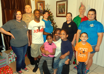 In front, seated, is Amesha Jackson, holding daughter Fantasia and son, Elijah, and next to them is Jaxson Allnet, son of Dep. Sgt. Shannon Cooper. In back are Sgt. Cooper, Cpl. Wayne Babin Jr., Jackson's son, Khalil; Lt. Jamie Penton, Capt. Angela Huff, Seth Penton, son of Lt. Penton; and Kaya Penton, daughter of Lt. Penton.