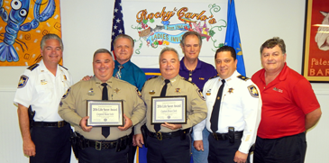Cpl. Shane Lulei and Caot. Brian Clark hold their Life-Saver Awards given them by the St. Bernard Kiwanis Club. With them, from left, are Sheriff James Pohlmann, Chief Deputy Richard Baumy, Mike Gorbaty, President of the Kiwanis Club; Maj. Chad Clark and Sam Catalanotto, chairman of the Life-Saver Committee.