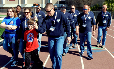 St. Bernard sheriff's deputies begin the opening parade, walking with participant James Dobson Jr. of Arabi, nearly nine years old.