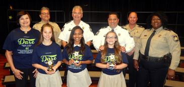 D.A.R.E. essay winners at Gauthier Elementary, from left in front, are Hayven Alexis, Jerzie Douglas and Kayla Billiot. In the back row are Gauthier Principal Lisa Young, D.A.R.E. instructor Sgt. Darrin Miller, Sheriff James Pohlmann, Maj. Chad Clark, Capt. Ronnie Martin and D.A.R.E. program supervisor Lt. Lisa Jackson.