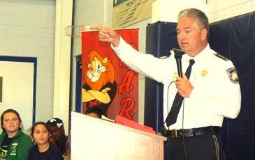 Sheriff James Pohlmann talks to students and parents at Davies Elementary.