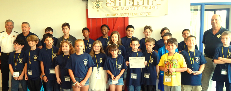 Graduates of the Sheriff's Office Junior Deputy Academy, along with Sheriff James Pohlmann, Capt. Charles Borchers and Dep. Sheriff Eric Eilers.