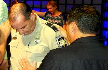 Det. Lt. Richard Mendel is prayed over.