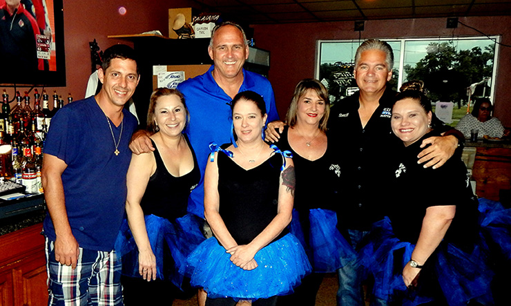 Shown at the fundraiser at Wimpy's bar in Chalmette are, from left, Parish Council member at-large Richie Lewis, employee Daffanie Buras, Parish President Guy McInnis, employee Michelle Varnado, owner Lori Cantrell, Sheriff James Pohlmann and employee Jessica Richardson.
