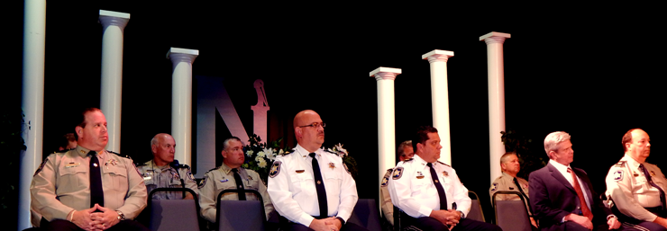 Sheriff's Office representatives on stage at Nunez College during the graduation.