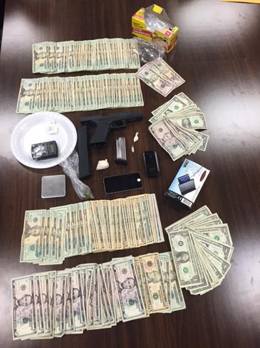 Gun, cocaine, heroin,  cash and drug paraphernalia seized.
