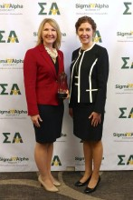 Melea Reicks Licht (left) is presented the 2018 Spirit of Ruth Award