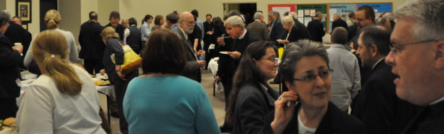 Participants enjoy a bountiful Monday night reception.