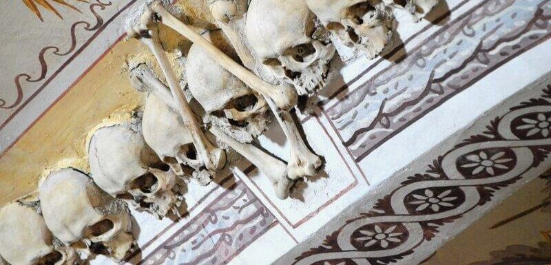 Decorative skulls and paintings, Chapel of Bones, Evora