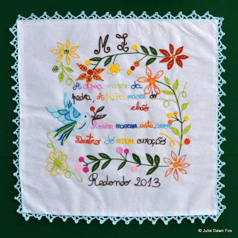 Embroidered handkerchief made of paper with colourful words and pictures of flowers