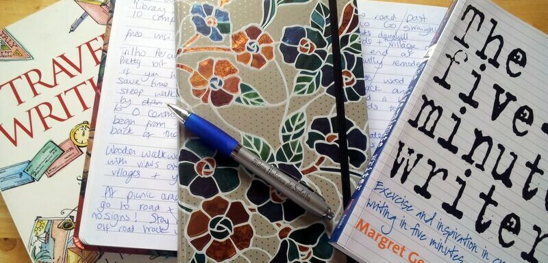 notebooks, pen and writing reference books
