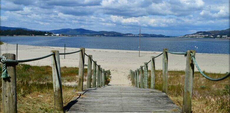 travelling in Portugal: wooden walkway to river beach, Caminha, Portugal