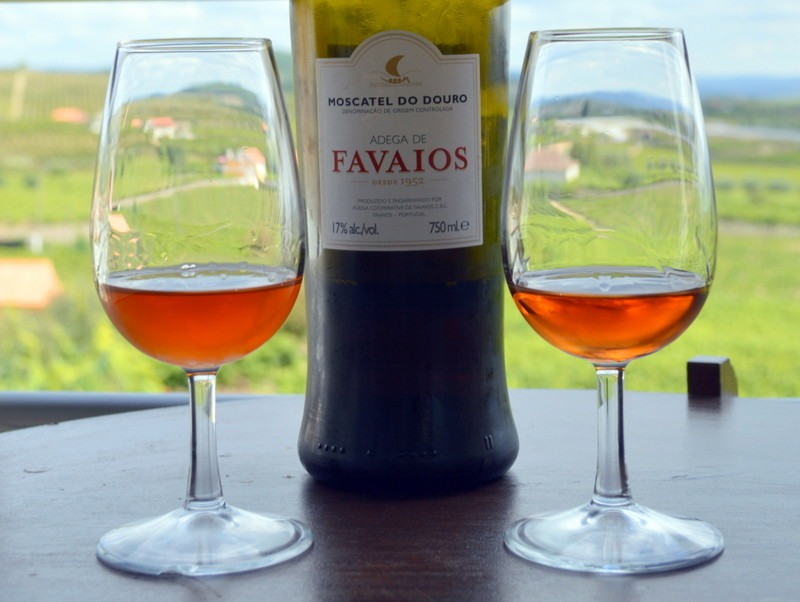 A bottle of Moscatel wine and glasses, Favaios, Portugal