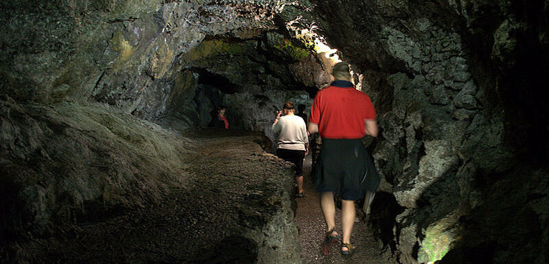 Walk through channels carved in volcanic rock by rivers of lava.