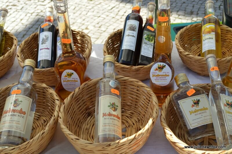 Bottles of Medronho 'firewater' in baskets. A traditional Algarve spirit. Not for the fainthearted!