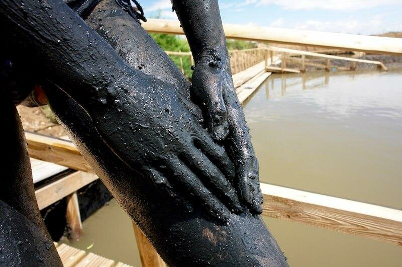 Applying the mud at Casto Marim salt pan spa, Eastern Algarve