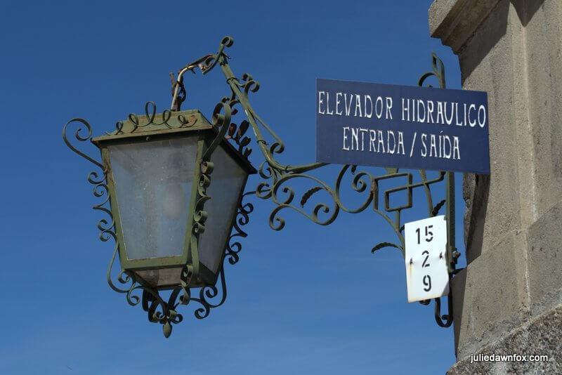 Swirly lamp and entrance to elevator, Bom Jesus, Braga