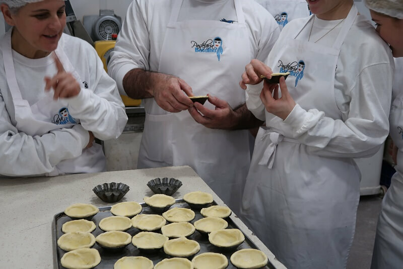 Moulding pastry cases. Pastel de nata workshop, Pastelaria Batalha in Lisbon