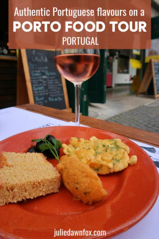 Glass of rose wine, cornbread and cod snacks