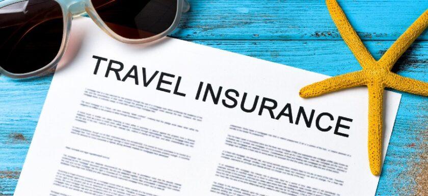 Sunglasses on blue desk. Travel insurance Document