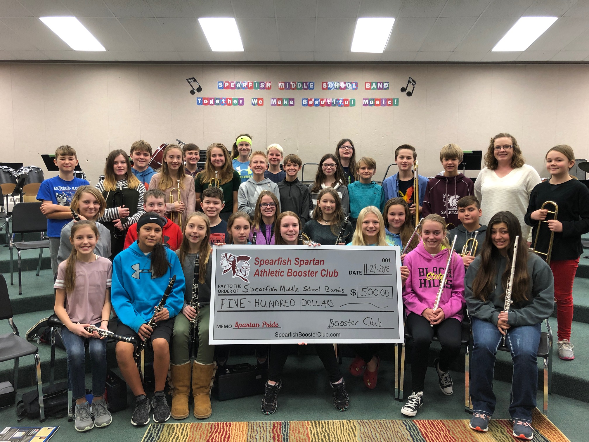 The Spearfish Spartan Athletic Booster Club presented a check in the amount of $500 to the Spearfish Middle School Band Program in gratitude for encouraging students to become involved in band, in hopes that they will continue on with their love of music at the high school level. The Booster Club's mission is to recognize student athletes and boost school spirit and community pride. Pictured are members of the 7th grade band with Mrs. Case, the middle school band director.