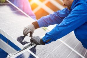 solar panel installer working on panel