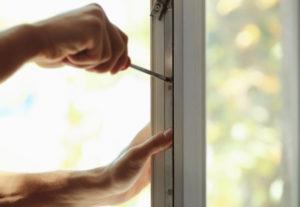 replacement window installer working on sash of window