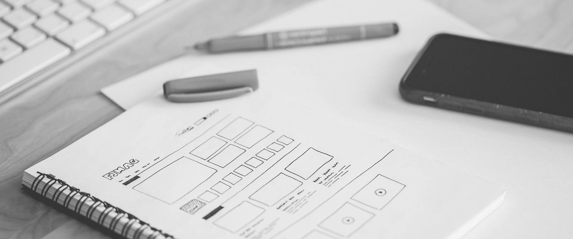 Website design wireframe on notebook paper