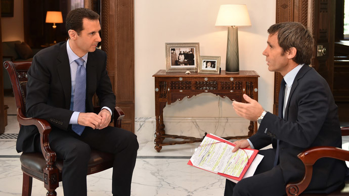 Syrian President Bashar Assad answering questions from France 2 journalist David Pujadas during an interview in Damascus. (AFP Photo / HO / SANA)