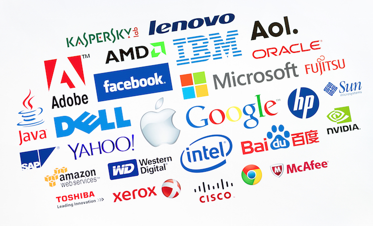 KIEV UKRAINE - MAY 22 2014: A logotype collection of well-known world top companies of computer technologies on a monitor screen. Include Google Apple Microsoft IBM Adobe Intel and other logo.