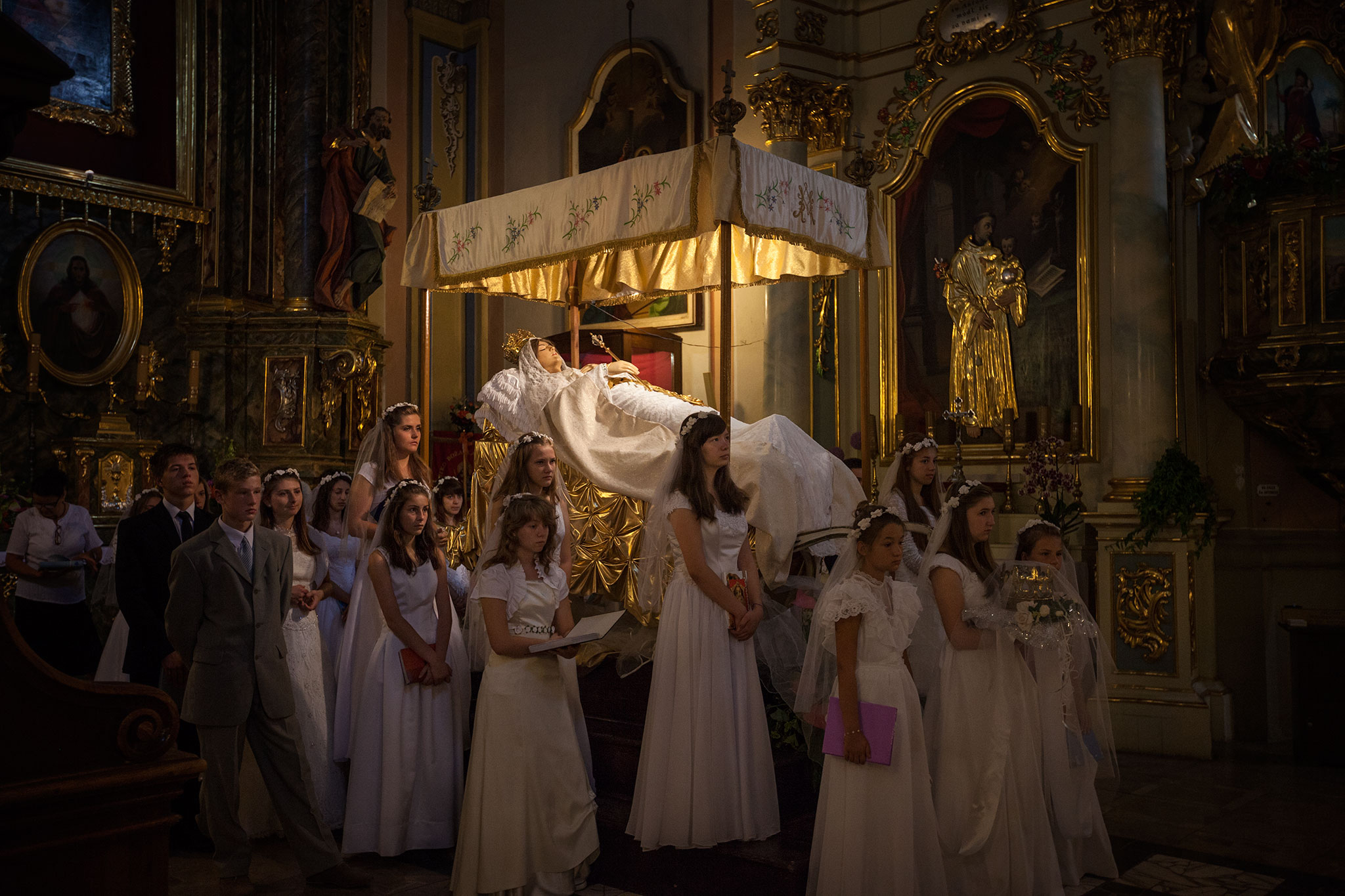 Mary is a magnet for young and old. On August 12, during a Mass celebrating her assumption into heaven, Roman Catholic youths guard a life-size figure in Kalwaria Pacławska, Poland. The Feast of the Assumption is a weeklong festival here.