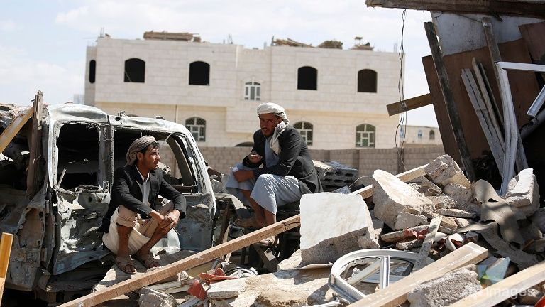 Men sit on the the rubble of a house damaged by Saudi-led airstrikes in Sanaa, Yemen on Jan 6, 2016. (Photo: AP/Hani Mohammed)
