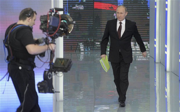 Russian Prime Minister Vladimir Putin arrives for a televised question-and-answer session in Moscow Photo: REUTERS/Alexsey Druginyn