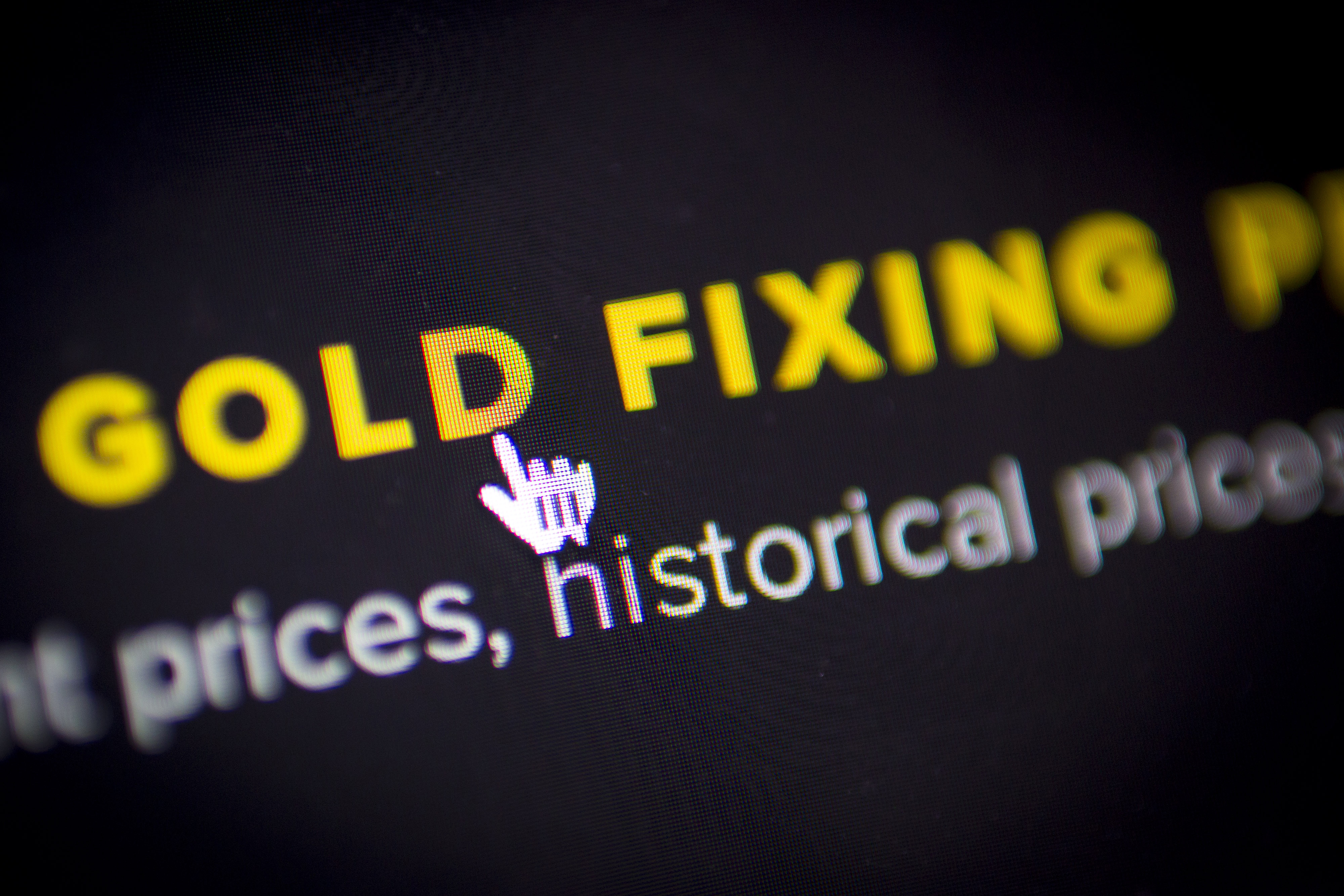 A mouse cursor is seen hovering over the words 'Gold Fixing' on the website of London Gold Market Fixing Ltd., the company owned by the banks that administer the London gold fix, in this arranged photograph taken in London, U.K., on Friday, Feb. 28, 2014. The London gold fix, the benchmark used by miners, jewelers and central banks to value the metal, may have been manipulated for a decade by the banks setting it, researchers say. The paper is the first to raise the possibility that the five banks overseeing the century-old rate -- Barclays Plc, Deutsche Bank AG, Bank of Nova Scotia, HSBC Holdings Plc and Societe Generale SA -- may have been actively working together to manipulate the benchmark. Photographer: Jason Alden/Bloomberg