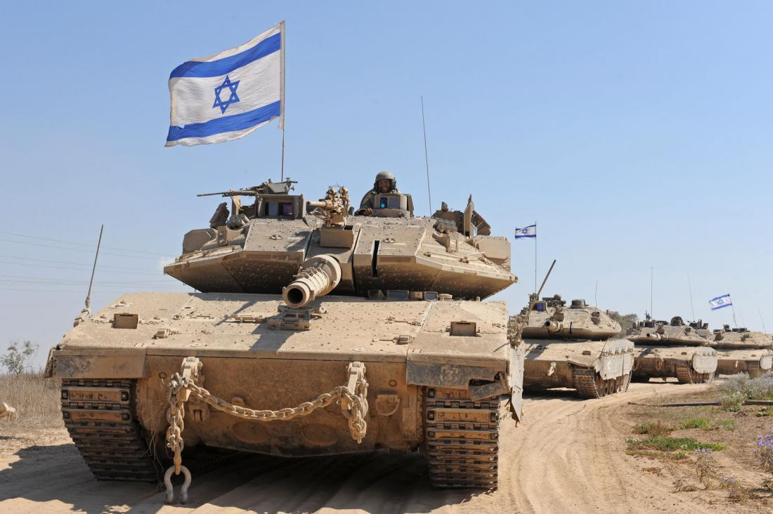 Israeli soldiers wait in Merkava tanks to enter Gaza near the Israel and Hamas controlled Gaza Strip border in southern Israel, August 2, 2014. National Security Adviser Susan rice urged a two-state solution for Israel and Palestine, while announcing a $40-billion military aid package for Israel -- the largest amount of U.S. aid ever given to any one country. UPI/Debbie Hill | License Photo