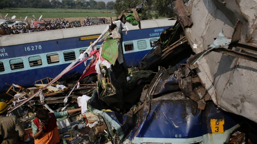 Rescuers work on the site of a train derailment accident in Kanpur Dehat, India,