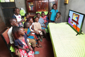 Children from a rural home in Ukambani, Kenya, able to continue education thanks to off-grid solar television.