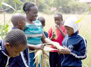 Steiner School Mbagathi: Gardening teacher Rose M Ingala with pupils