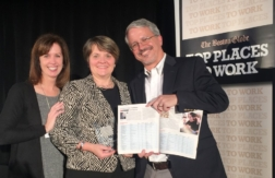 Lisa Dolan, Lisa Brothers, and Gary Pease hold award