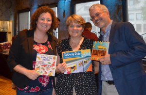 Deb Danik, Lisa Brothers, and Gary Pease with books