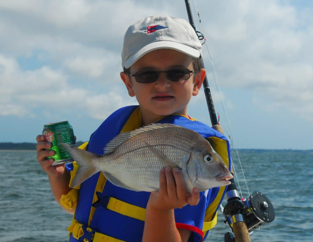 Peconic Water Sports Fishing Camp on the North Fork of Long Island- Camper holding a Porgy