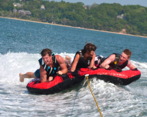 Tubing with Peconic Water Sports on a boat charter in the Hamptons near Sag Harbor, NY