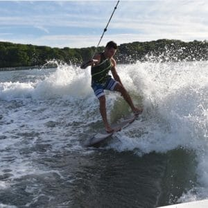 Chris Inzerillo Wakesurfing with Peconic Water Sports during a boat rental in the Hamptons near Shelter Island in Long Island, New York