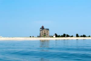 Cedar Point Lighthouse as seen from a rental jet ski during an around shelter island tour in long island