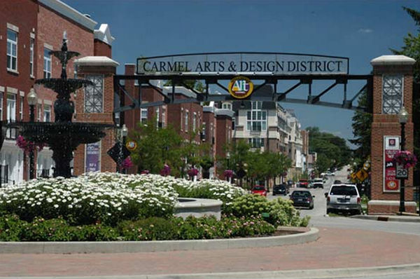 "Main St. at western fountain and gateway arch entryway to rebranded ""Arts and Design Distrct."""