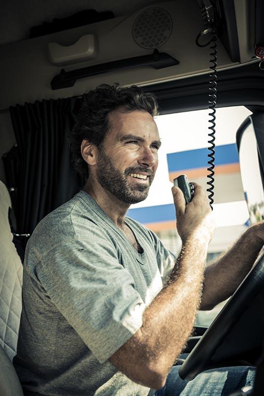 Truck Driver Using His CB Radio