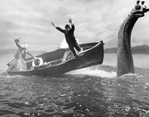 """A $25,000 mechanical Loch Ness monster sends actors tumbling in the water in this scene for United Artists' thriller """"The Private Life of Sherlock Holmes"""" which was being filmed in Scotland, Oct. 1969. Dr. Watson (Colin Blakely) leaps out of boat at right, while Gabrielle (Genevieve Page) and Sherlock Holmes (Robert Stephens) are struggling to keep their balance. The mechanical monster has disappeared into the 754-foot-deep loch and a San Francisco Insurance company says it is prepared to pay off. A fireman's fund spokesman says the monster itself isn't covered by insurance, but production delay costs because of the disappearance are insured. (AP Photo)"""
